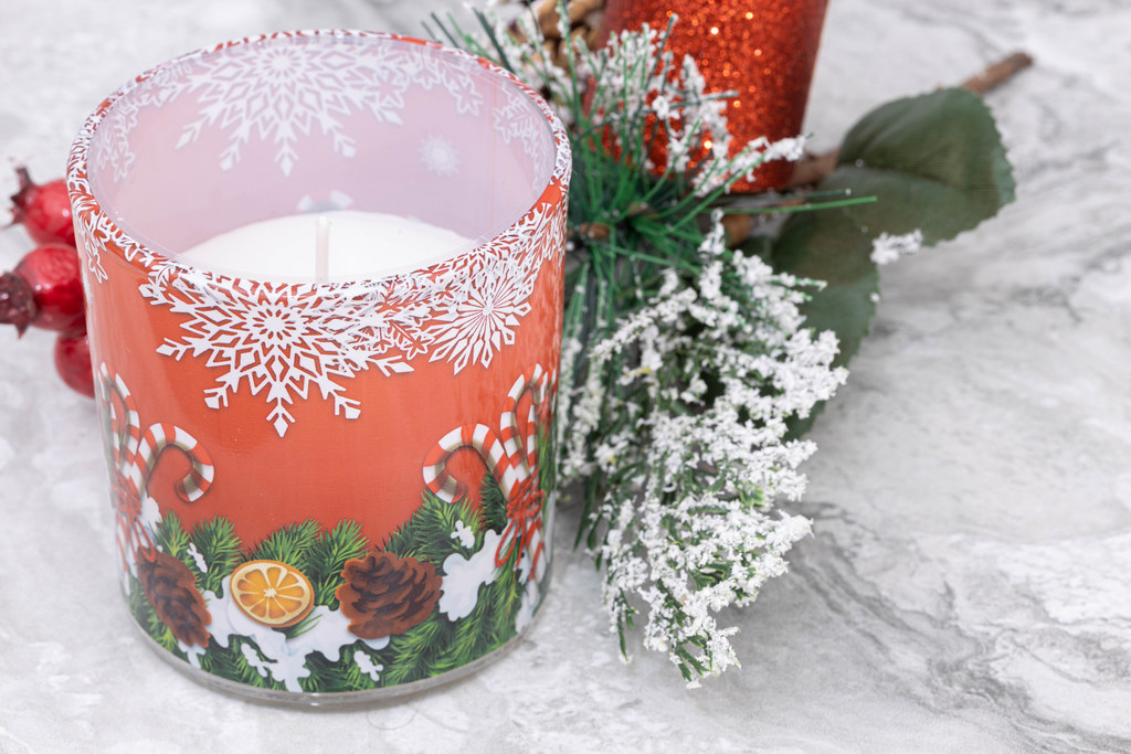 Christmass Candle and winter decoration with frozen branches