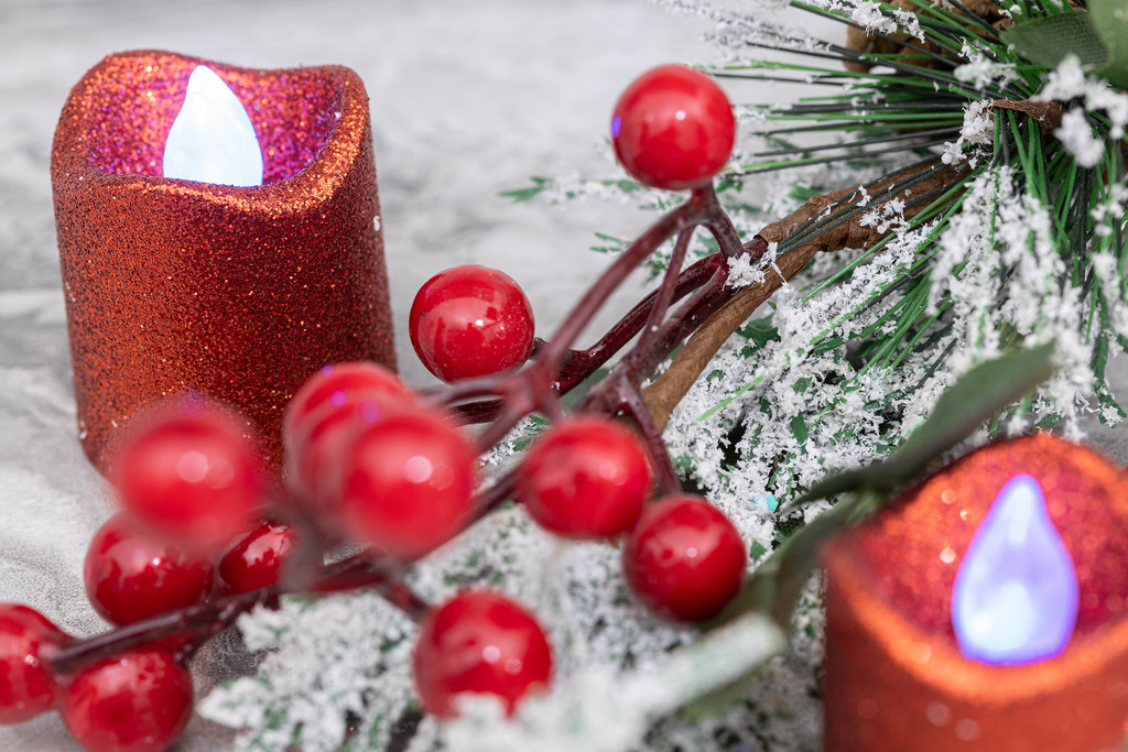 Candles and winter Christmass decoration with frozen branches