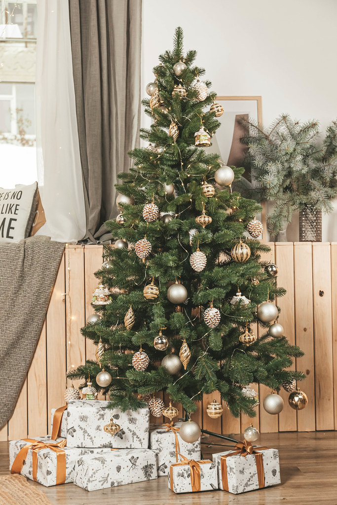 Decorated christmas tree in living room interior with gifts