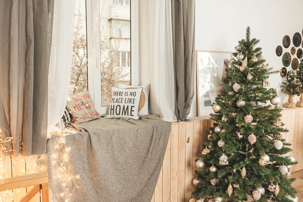 Beautiful christmas room with decorated christmas tree and window