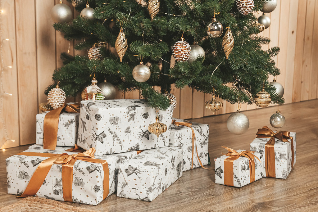 Holiday background with gifts and christmas tree
