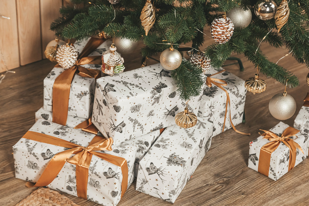 Many gifts under the decorated christmas tree