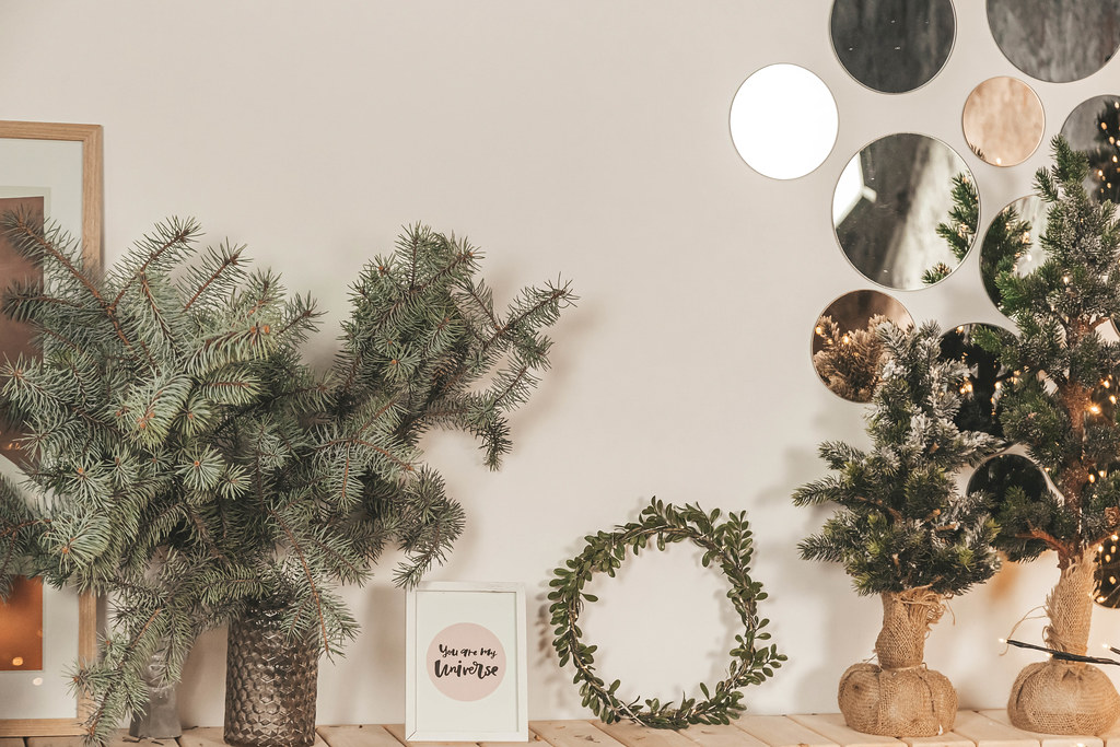 Christmas home decor with wreath and branches xmas tree