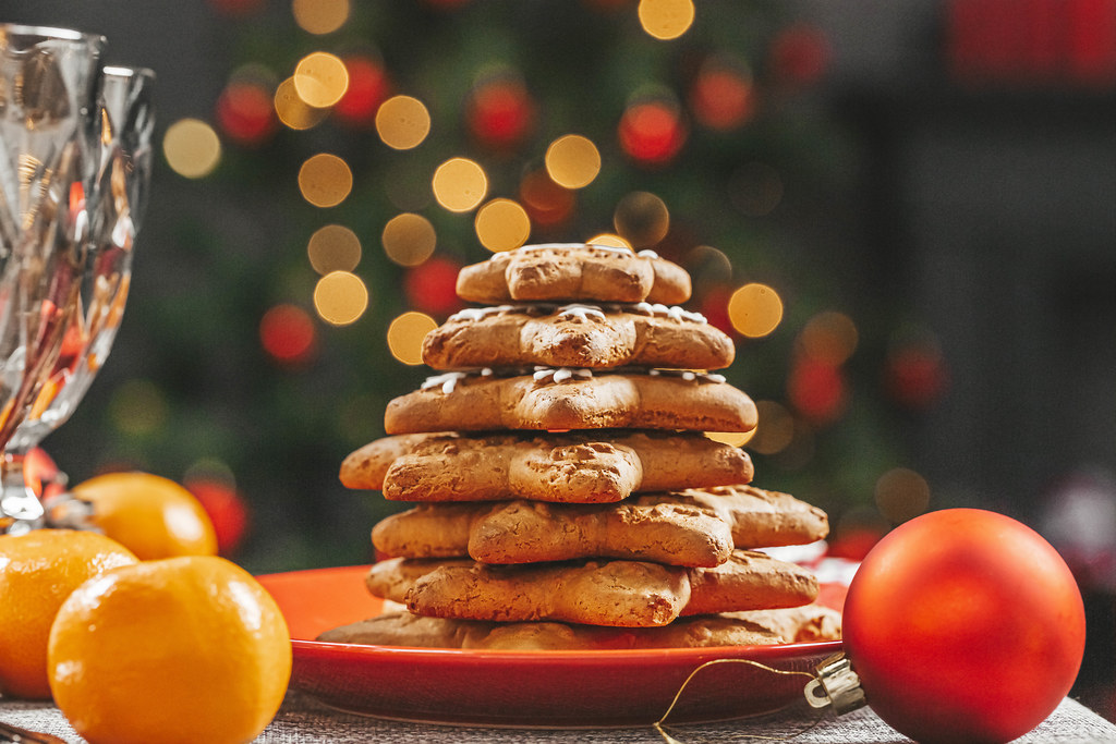 Stack of gingerbread in a red plate on a new year's background bokeh