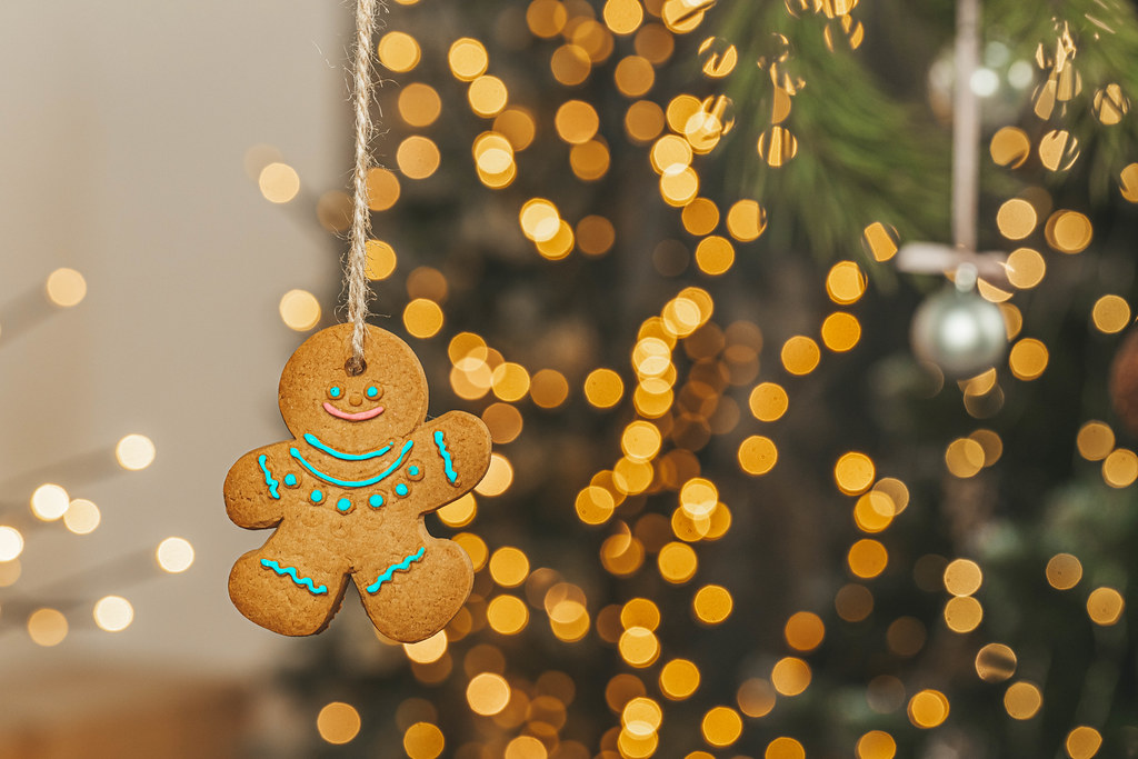 Gingerbread man hanging on golden bokeh background