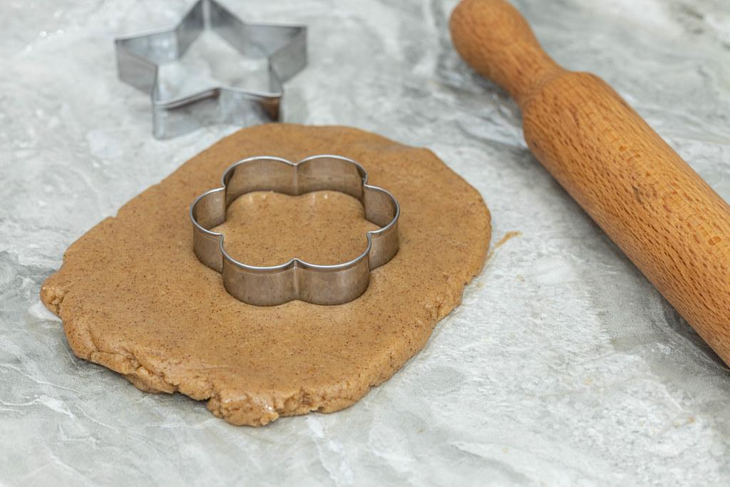 Preparing Christmas cookies with cookie templates