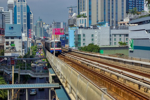 BTS Skytrain approaching Asoke station on Sukhumvit road in Bangkok, Thailand