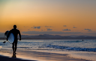 Surfing at Sunset - Byron Bay