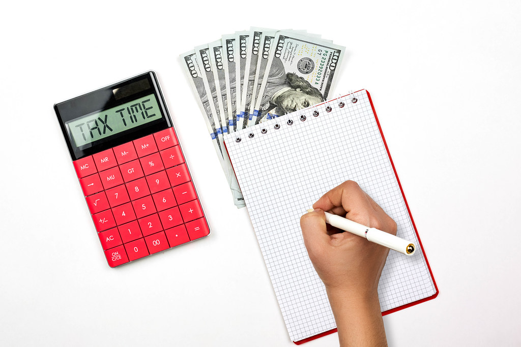 Tax time concept with calculator and us dollars