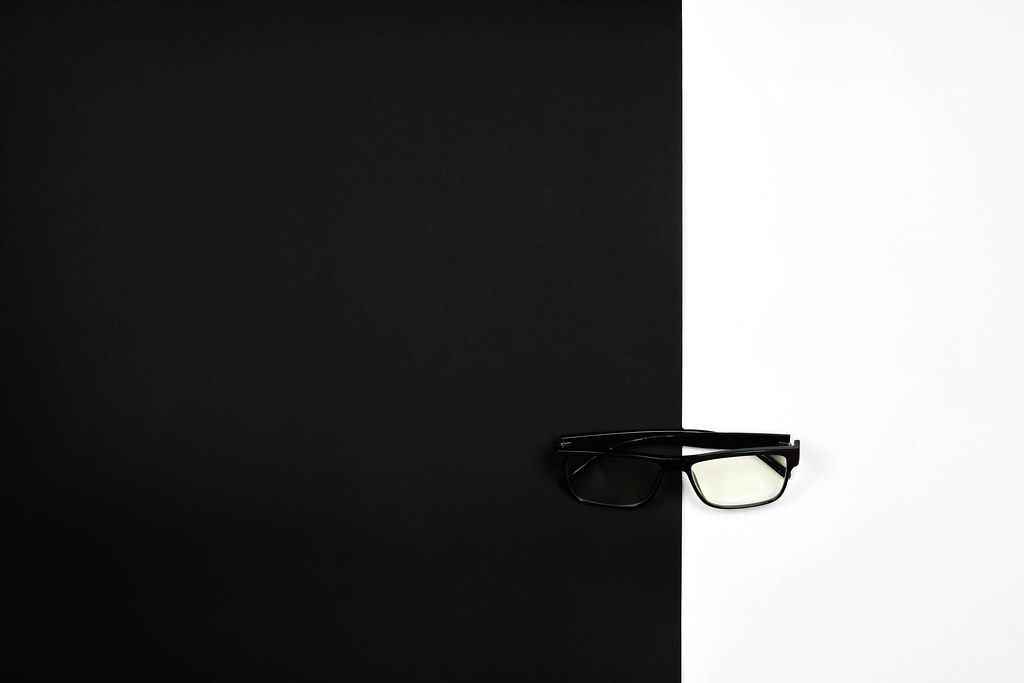 Eyeglasses on black and white. Creative vision concept.