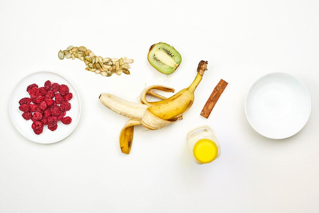Preparing dieting milkshake with tropical fruits