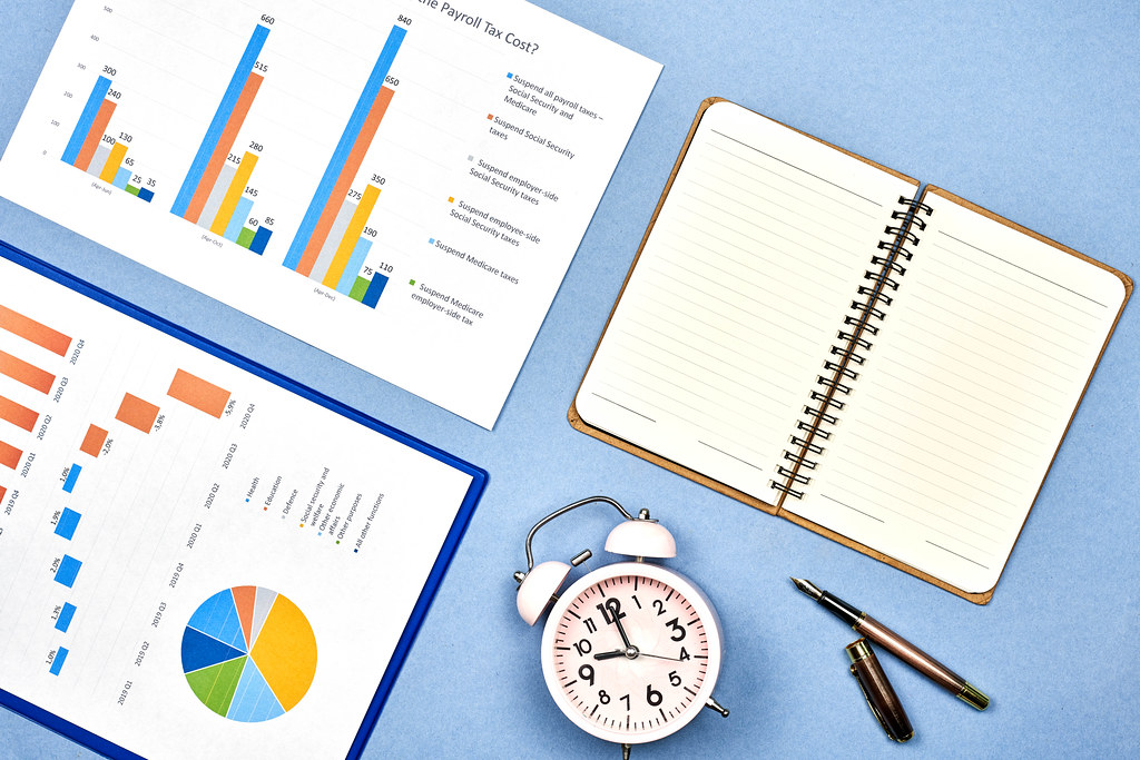 Time to pay taxes. Business documents with graphs and charts