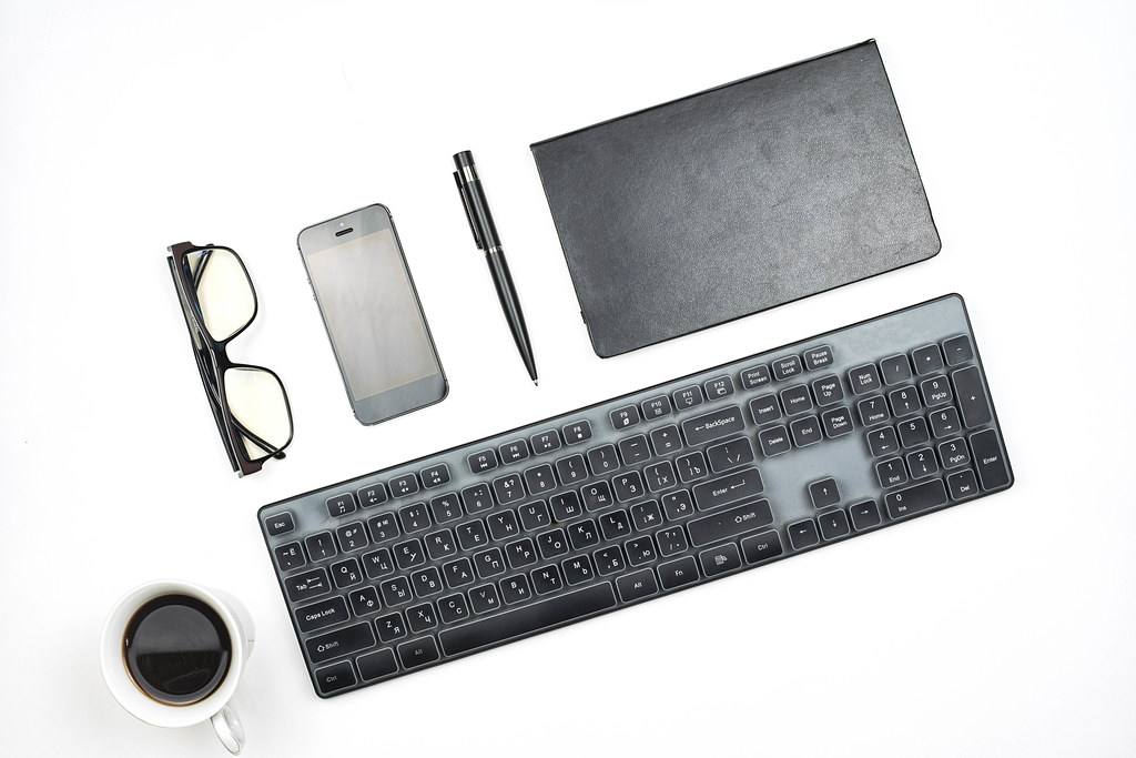 Trendy arrangement of black office supplies on white background