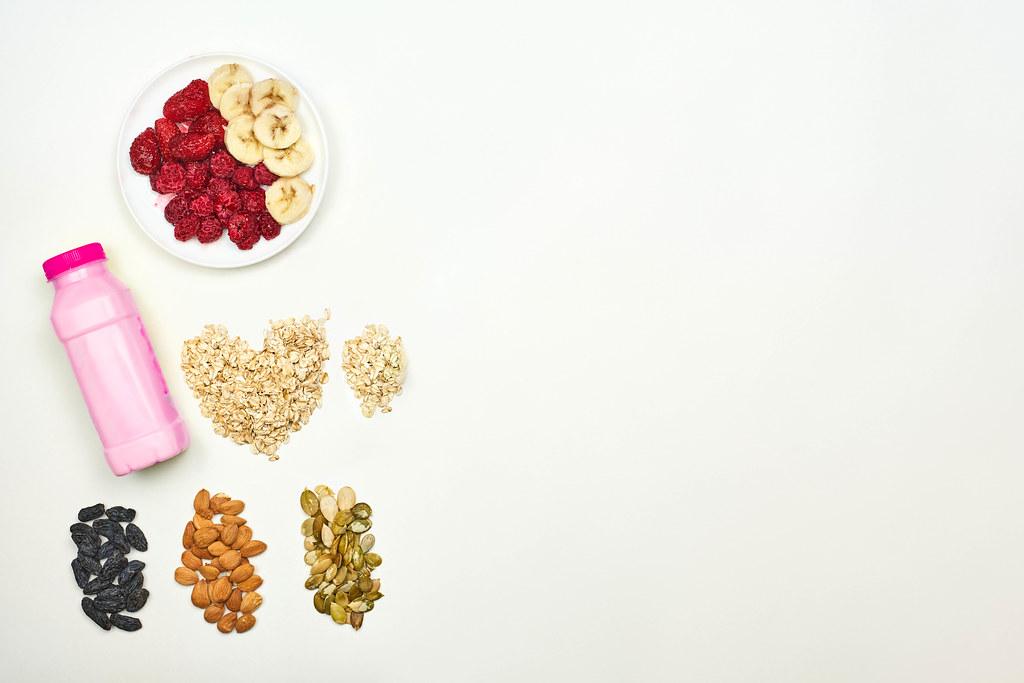 Fruit milkshake with oatmeal, raisins, apricot and pumpkin seeds