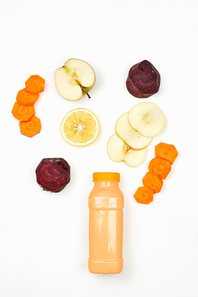 Healthy dieting smoothie with beetroot, carrot, lemon and apple slices