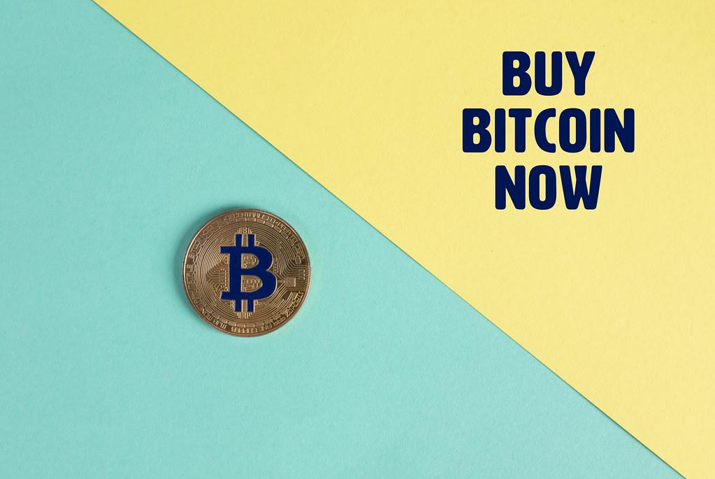 Golden Bitcoin coin and Buy Bitcoin Now text