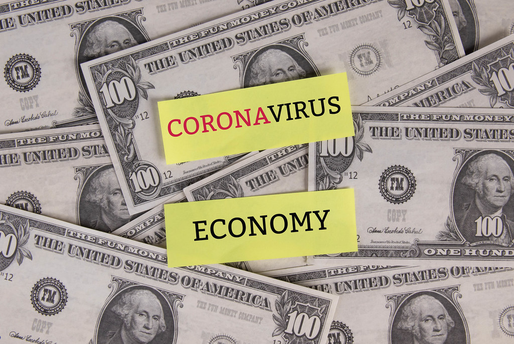 Coronavirus economy text with the US dollars banknotes