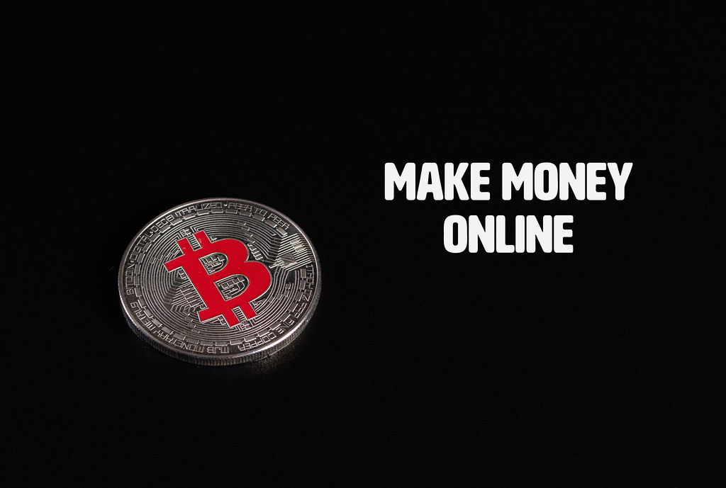Silver Bitcoin coin with Make Money Online text on black background