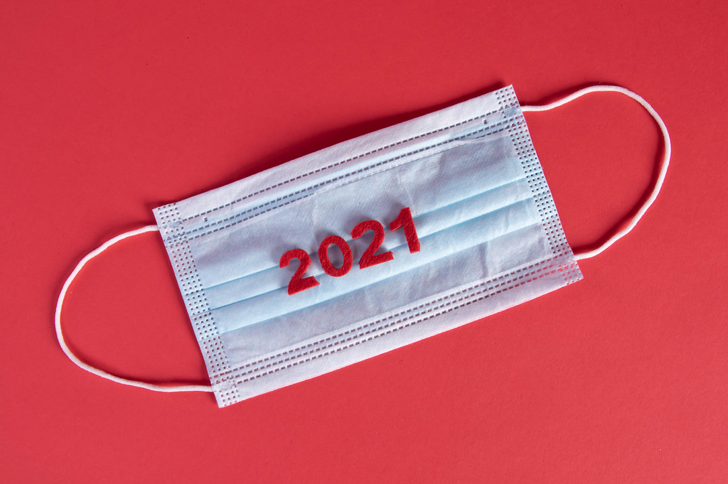 Medical face mask with 2021 text on red background