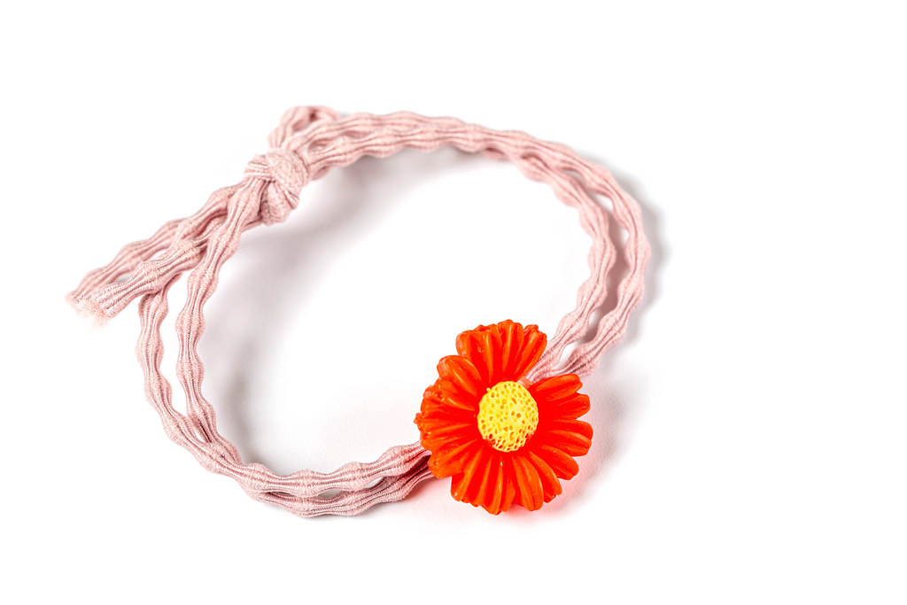 Pink elastic hair band with red flower