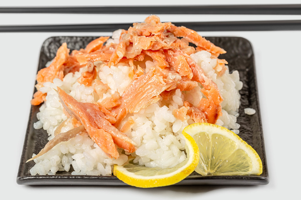 Rice with fish slices and lemon, close-up