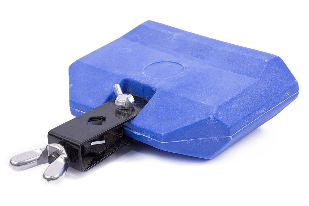 Blue Plastic Drum Cowbell instrument above white background