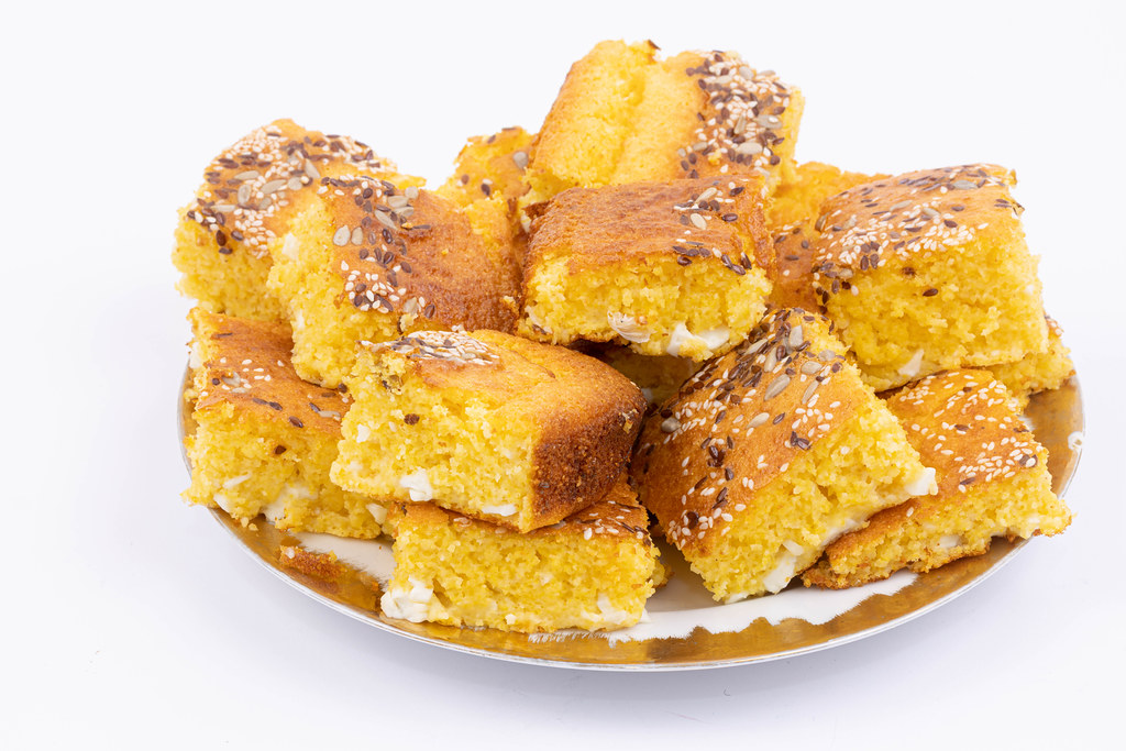 Cornbread on the plate above white background