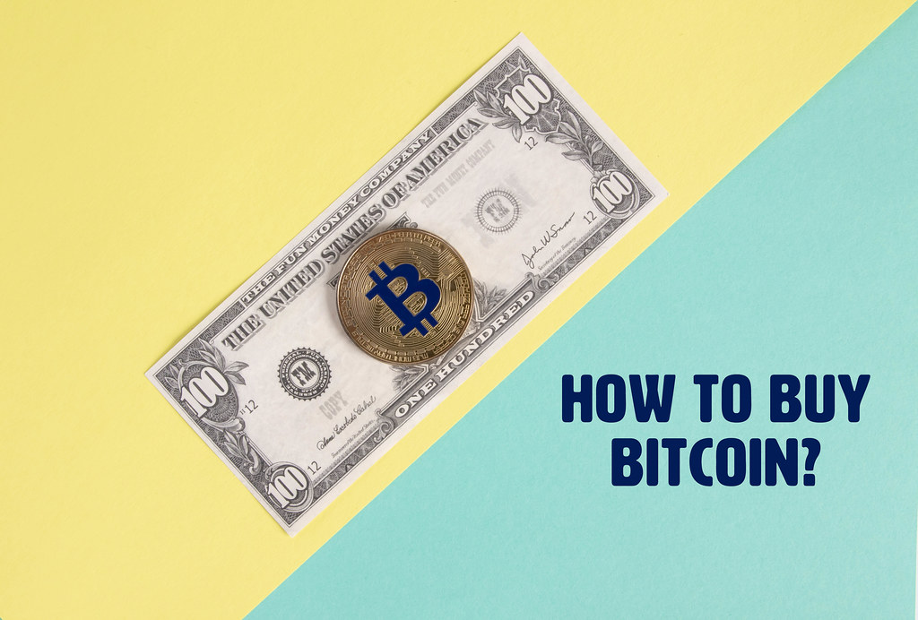 Golden Bitcoin coin on the  one hundred dollar banknote and How to buy Bitcoin text