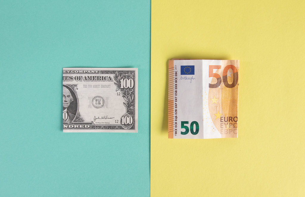 Folded 100 Dollar and 50 Euro banknotes
