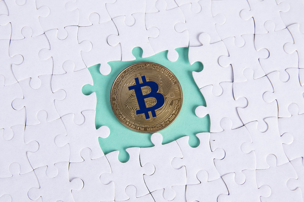 Missing puzzle pieces and golden Bitcoin coin