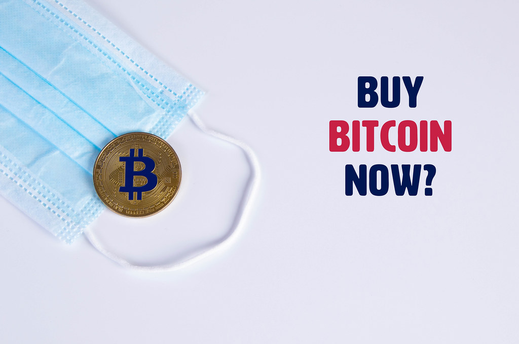 Golden Bitcoin with protective face mask and Buy Bitcoin Now text