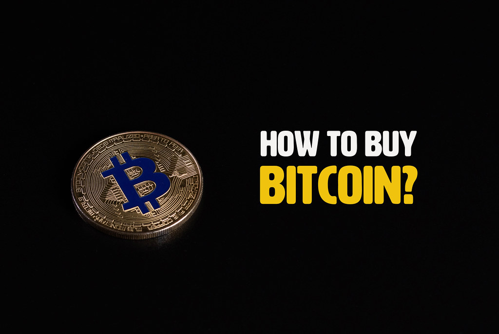Golden Bitcoin coin with How to buy Bitcoin text on black background
