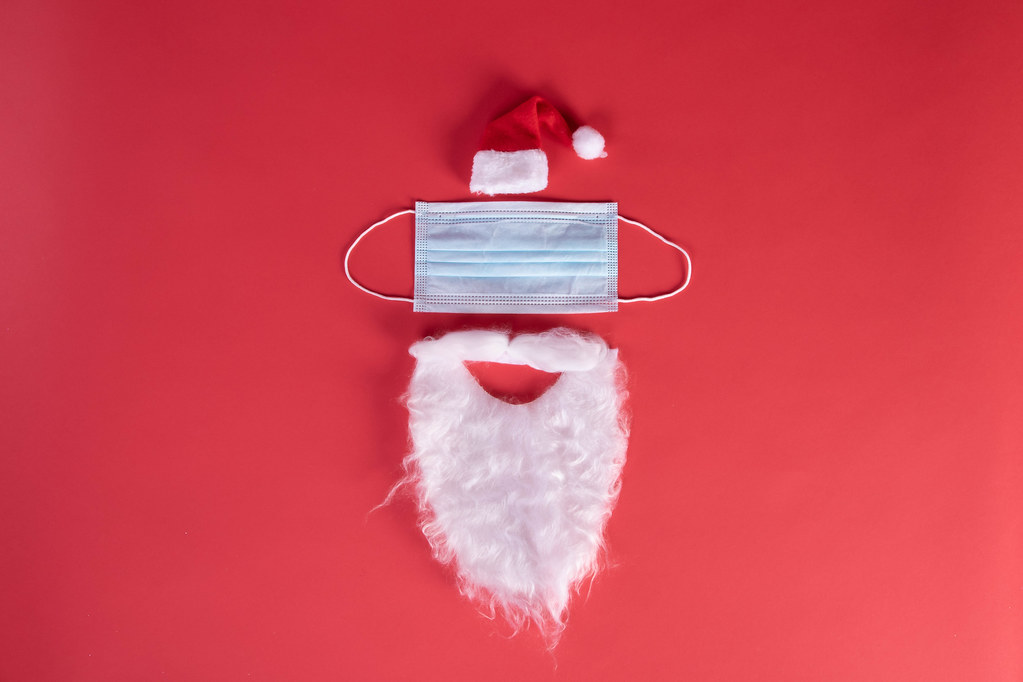 Festive christmas Santa Claus face made from face mask and decorations