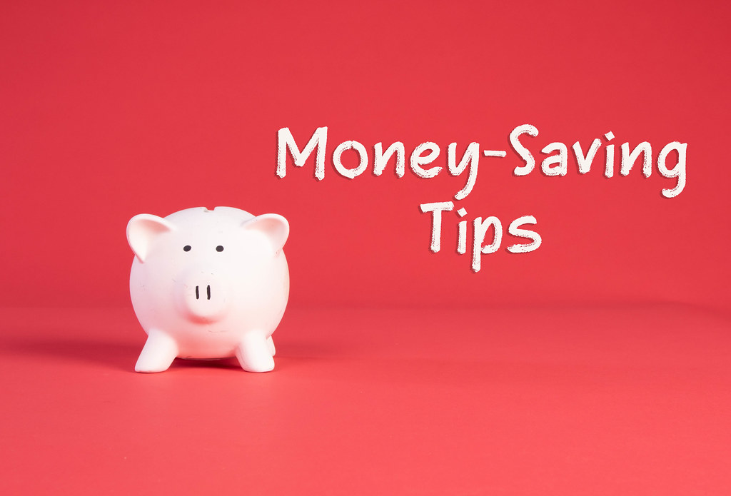 Piggy bank with Money-Saving Tips text on red background