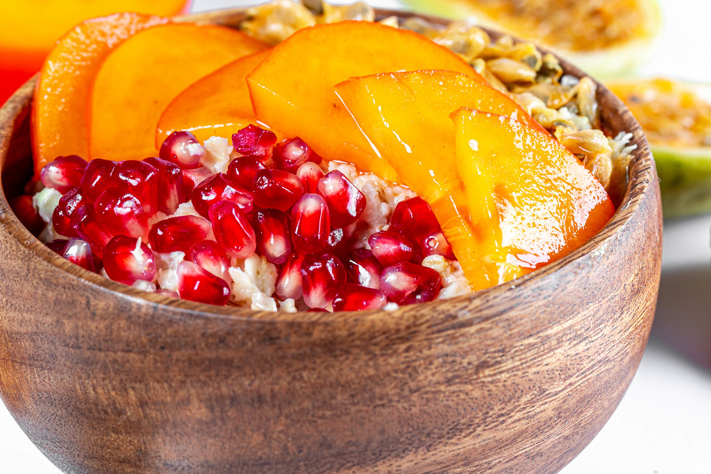 Close-up, wooden bowl with oatmeal and fruit