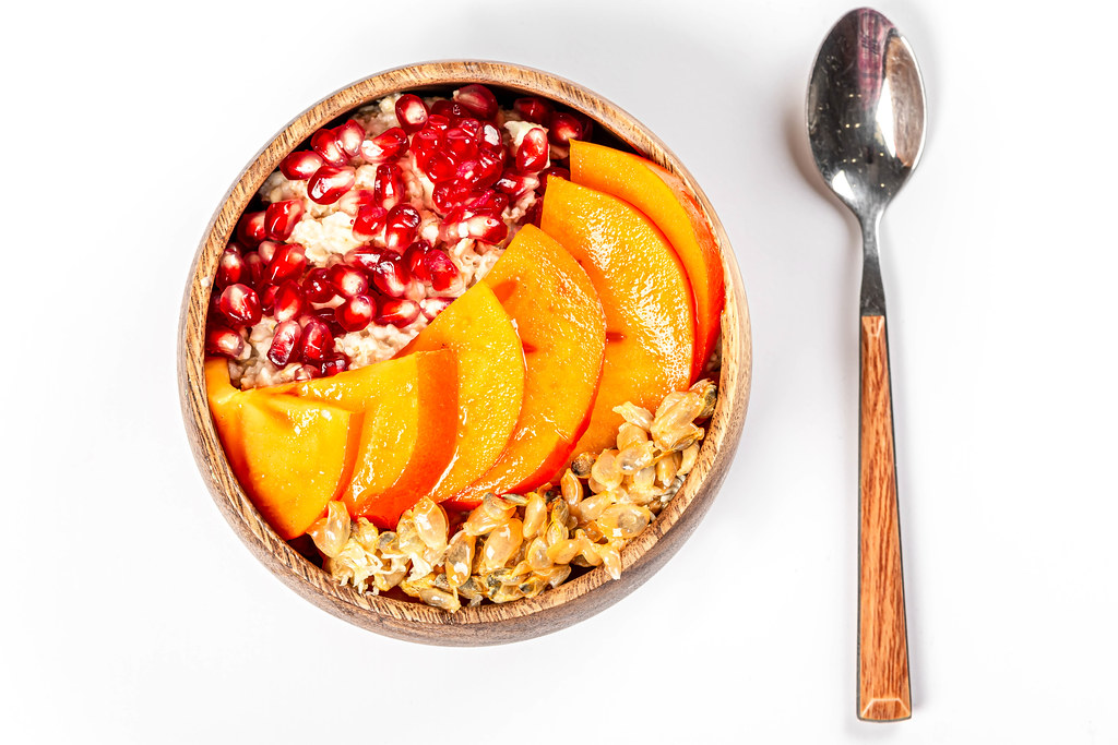 Top view, oatmeal with fresh fruit