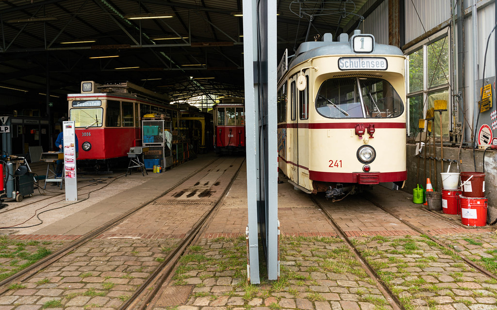 Tram depot with many retro trams inside, all in perfect condition