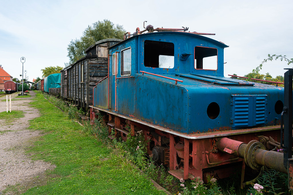 Old German abandoned locomotive in front of the wooden wagon train
