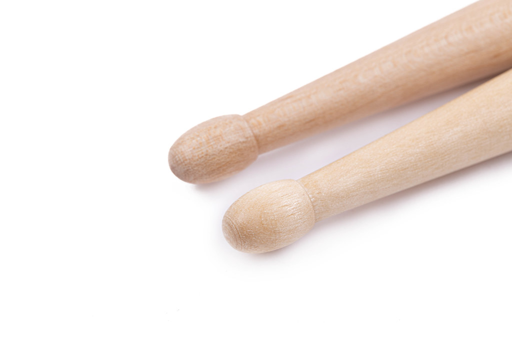 Wooden Drumsticks in closeup image with copy space above white