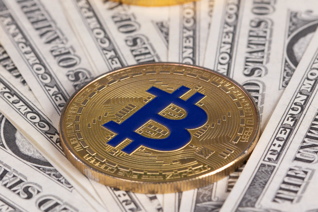 Golden Bitcoin on money bills