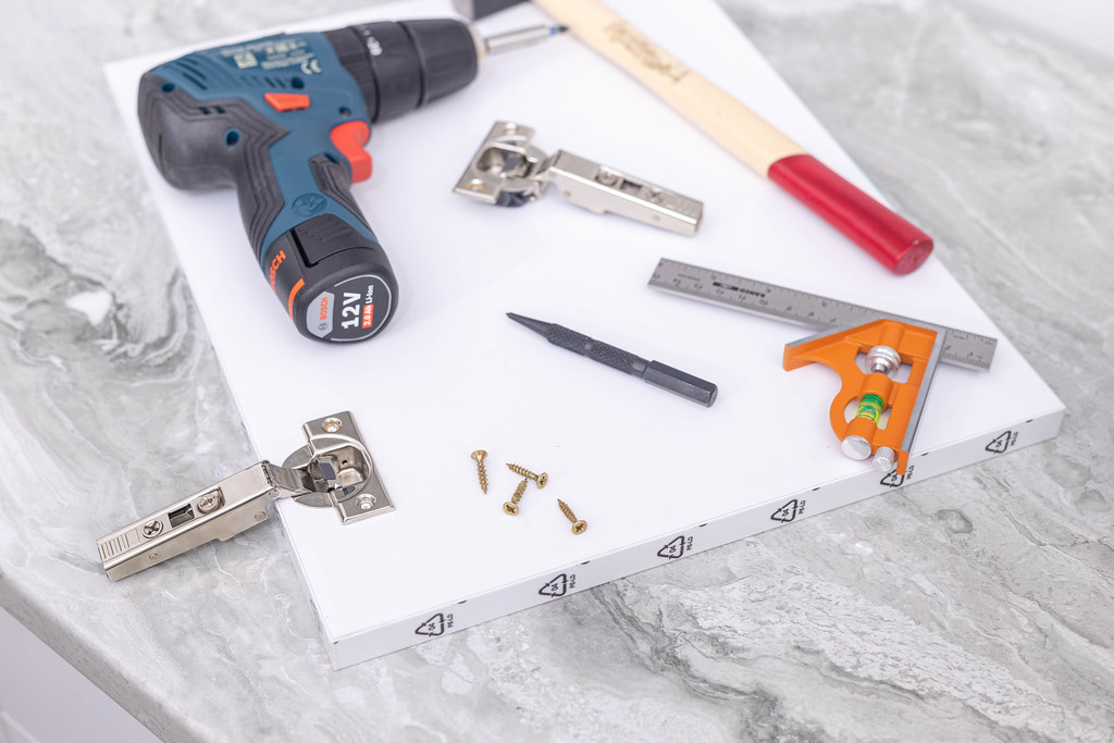 Woodworker Tools for repairing Hinges on the kitchen cabinet doors