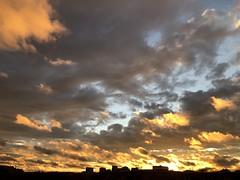 Dramatic sunset sky over Georgetown, glimpse of Rosslyn skyline, Washington, D.C.