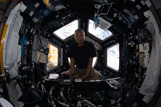 Expedition 64 Flight Engineer Soichi Noguchi relaxes inside the seven-windowed cupola