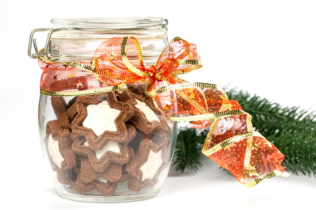 Glass jar with star cookies, close-up