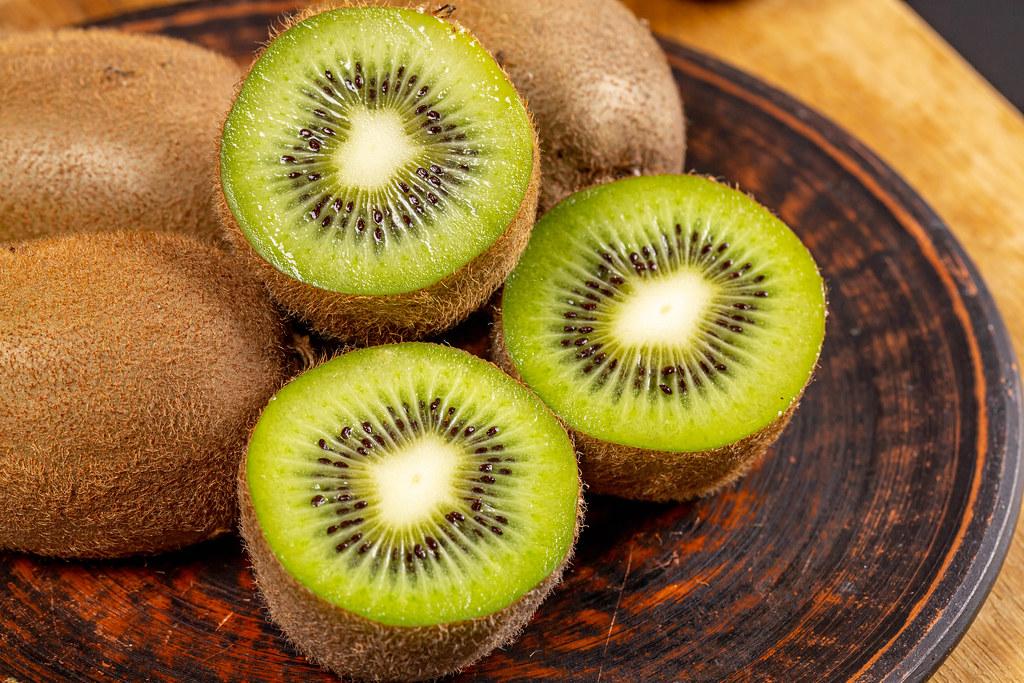 Halves of fresh kiwi fruit and whole, close-up