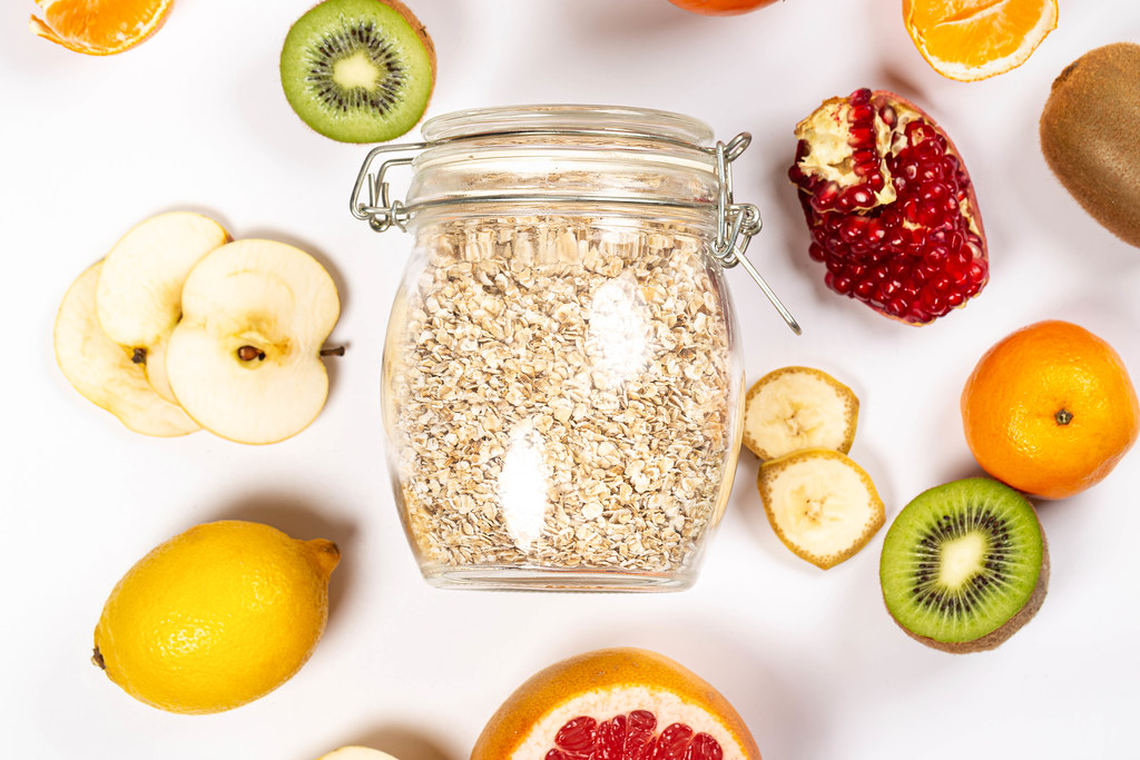 Top view, jar of oatmeal with fresh fruit