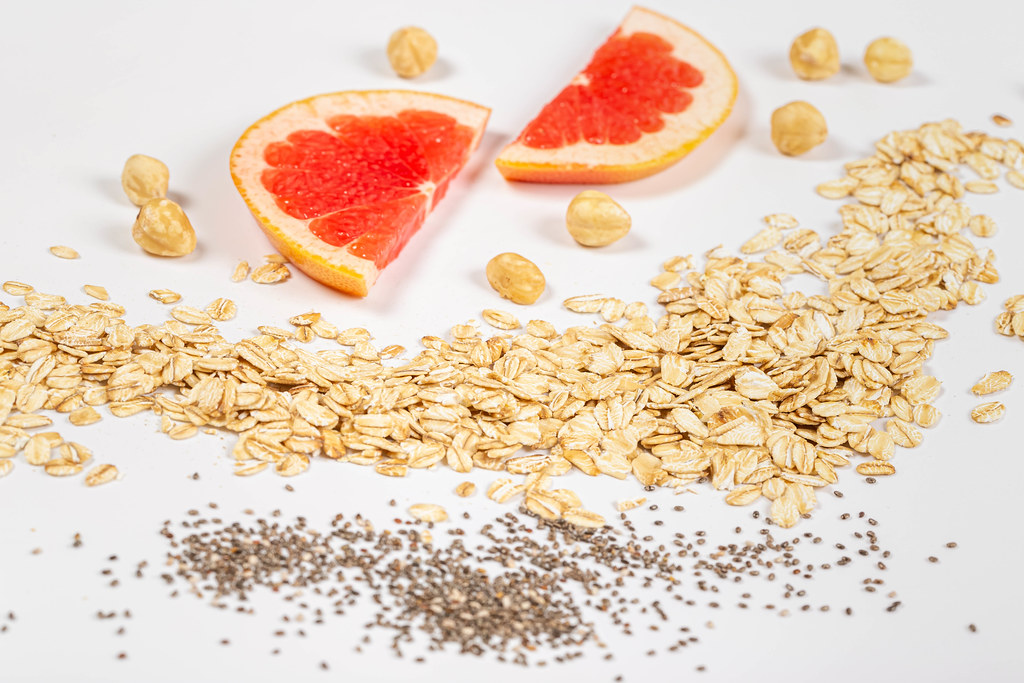 Close-up of oatmeal, chia seeds, hazelnuts and grapefruit pieces