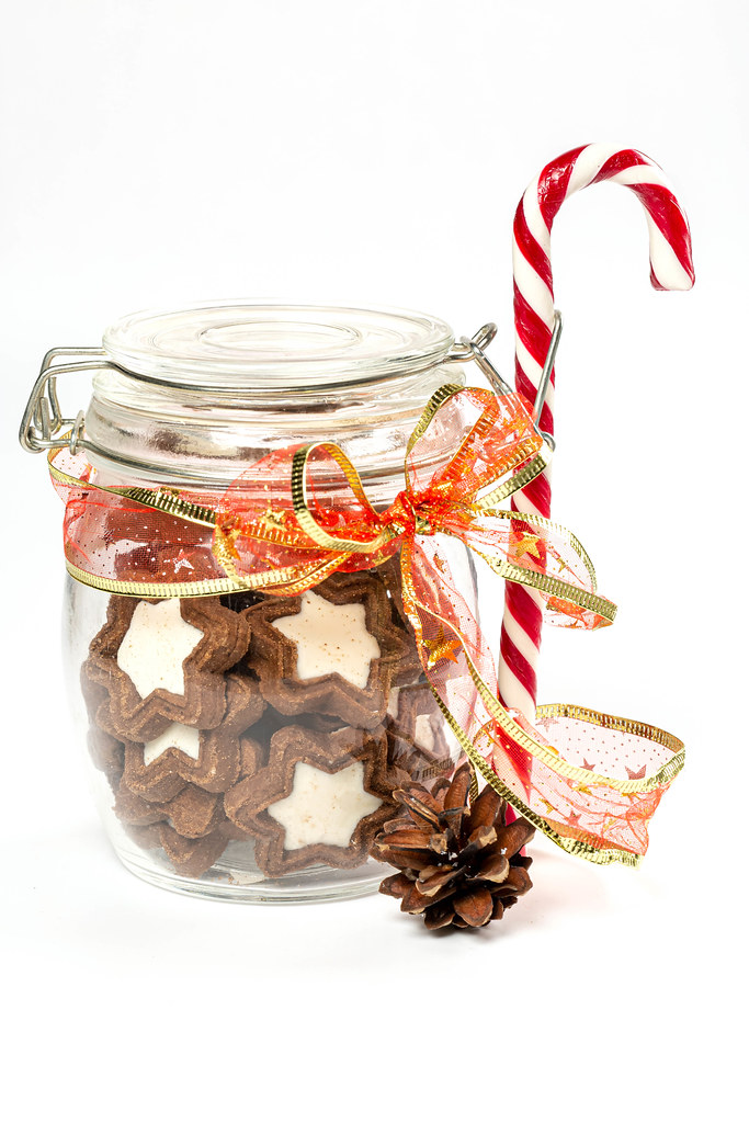 Jar of star cookies, lollipop cane and pine cone
