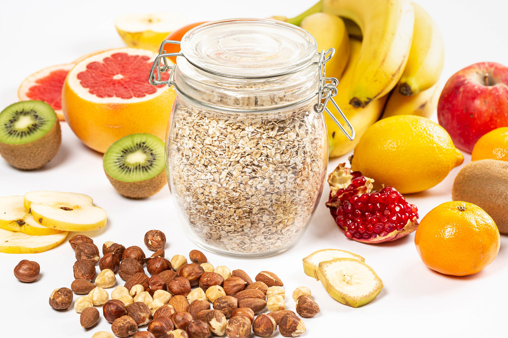 Healthy lifestyle concept, nuts, different fruits and oatmeal
