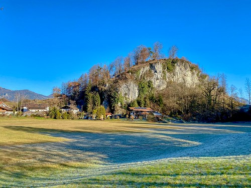 Meadow and hill with some houses on a cold autumn morning near Oberaudorf in Bavaria, Germany
